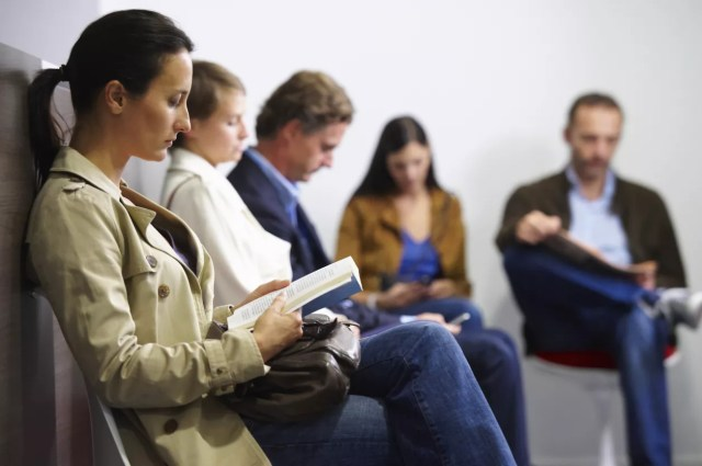Photo of people waiting in doctors office.