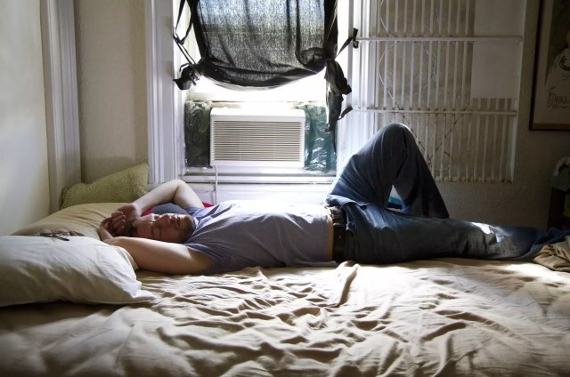 A man sleeps during the day due to chronic fatigue syndrome causing sleepiness