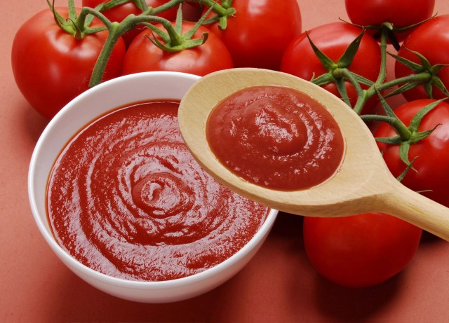 Tomato sauce and tomatoes on the vine