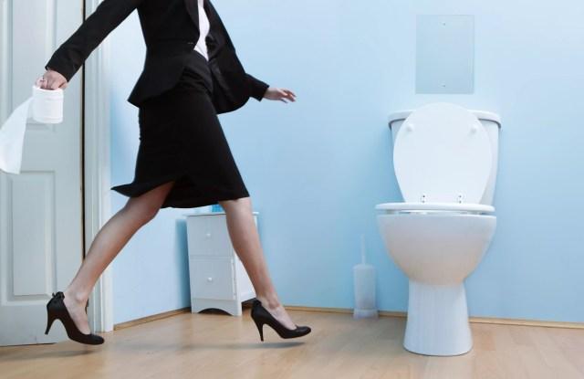 woman running to bathroom