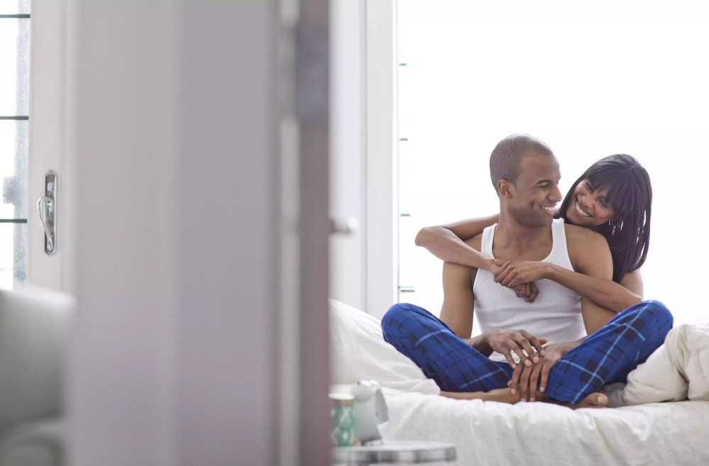 African American couple on bed