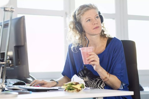 Mid adult woman having lunch break