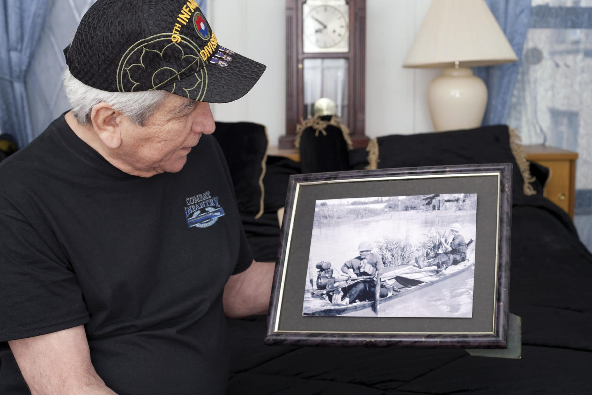 Vietnam War Veteran Looks At Old War Photo Of Himself