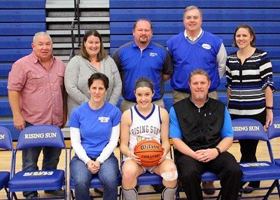 Lucy Carrigan is pictured with her mother Molly Martin and father Jeremy Martin as she was recognized for making the 1000 point club. Coaches she has played for are