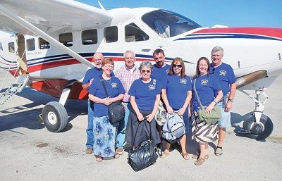 Leaving Haiti in a 10 passenger plane are front row