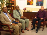The Taiwos with Dr. Ellis Hackler on the set of Dove Media