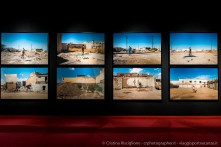 Pistas de baile (Pista da ballo), 2016. Stampa su carta cotone. Prostituta transessuale in piedi sul pavimento della pista da ballo del club demolito a Ciudad Juárez, Mexico. 125x185 cm, con cornice