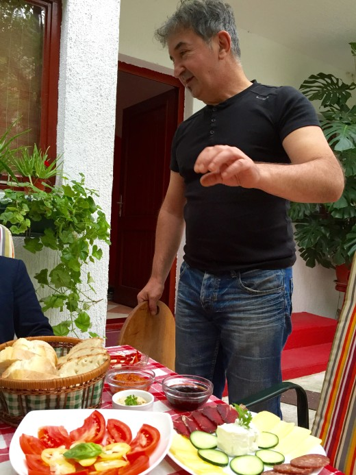 Emir serving us his delicious Bosnian breakfast in Mostar