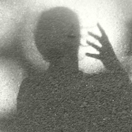 photo of shadow of a head and hand