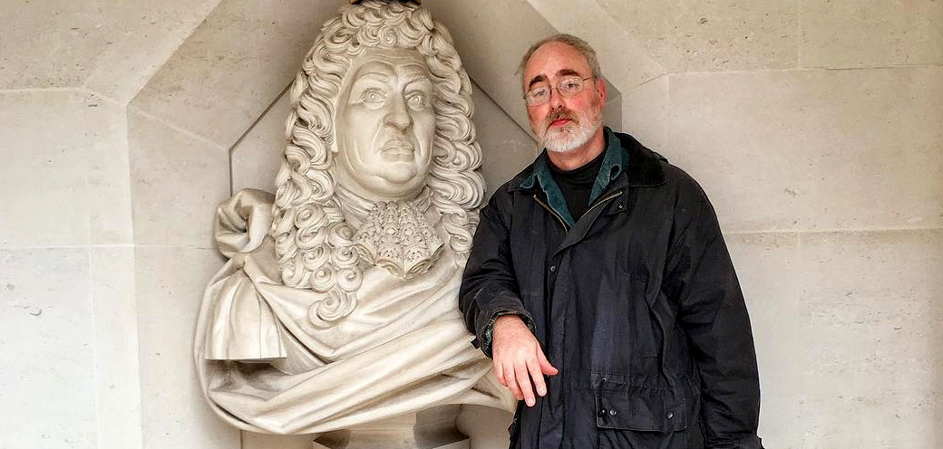 Dave leaning on a bust of Samuel Pepys