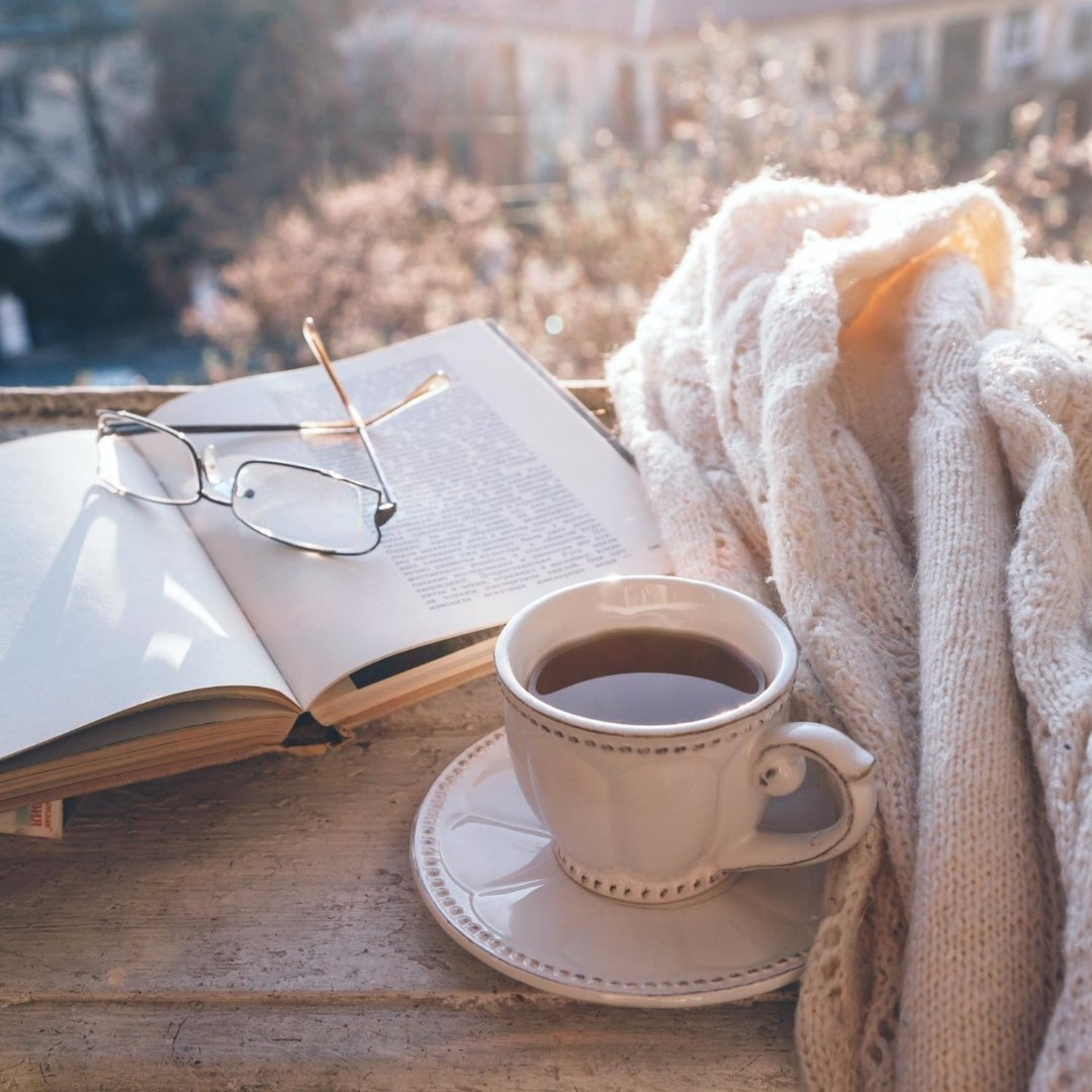 Reading for blogging ideas with hot tea