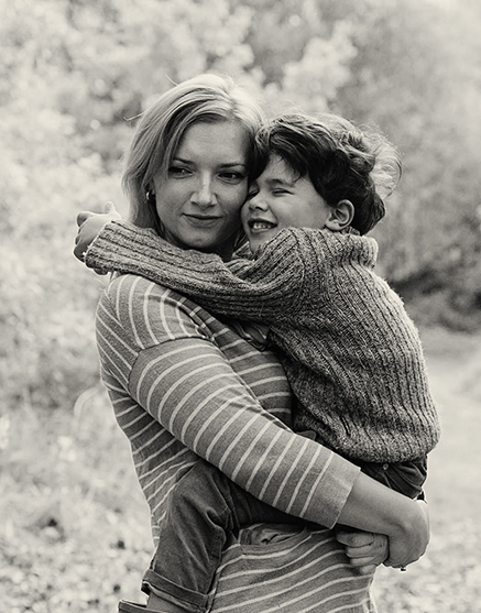 Victoria Ward holding her young son in her arms