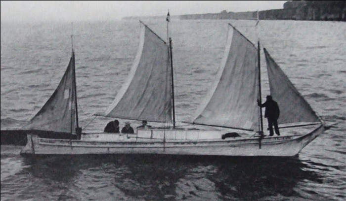 Tilkum embarking with Discovery Island in the background and patches on her sails.