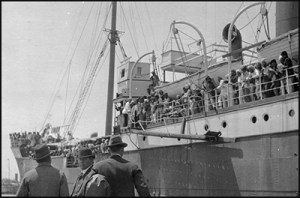 Canadian Immigration officials approach the Komagata Maru filled with Sikhs wishing to immigrate to Canada
