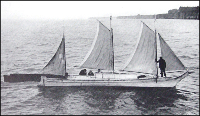 The dugout canoe Tillikum re-rigged for her circumnavigation. Note the patches on the aft sail.