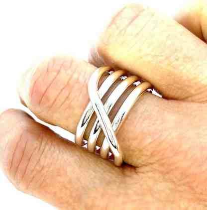 Medusa ring on finger