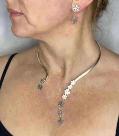 Snowflake torc on neck