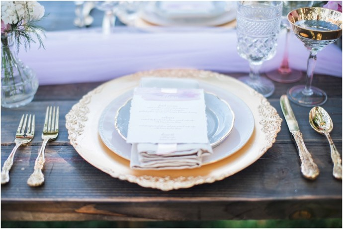 Gold and pink wedding table settings with soft romantic details