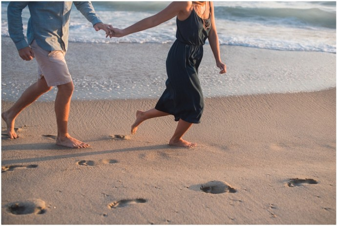 Artistic portrait of a couple running at the beach