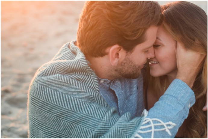 Close up portrait of a couple kissing at the beach