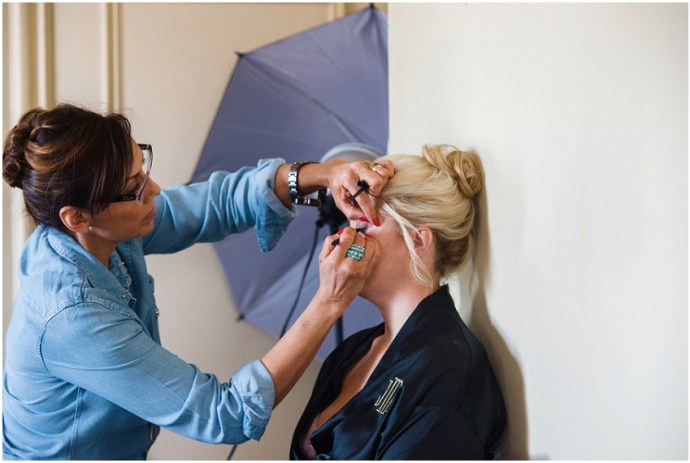 Bridesmaid getting her make up done before a wedding