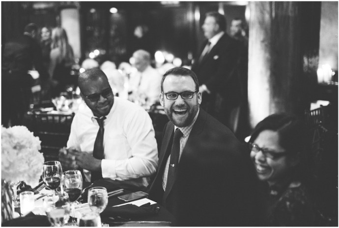 Guests enjoying themselves and laughing at a wedding