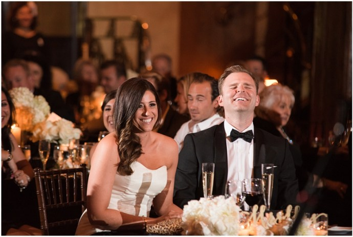 Bride and groom listening to speeches during a wedding