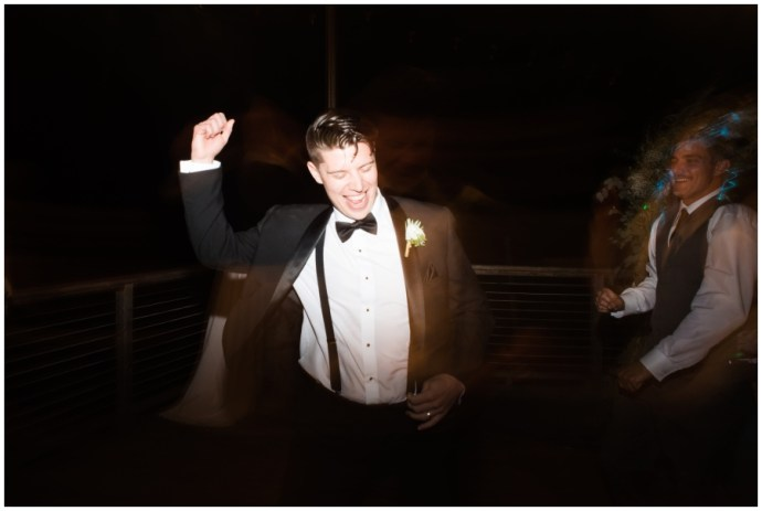 Groom dancing at a Crystal Cove Wedding. Photographed with on camera flash and a dragged shutter