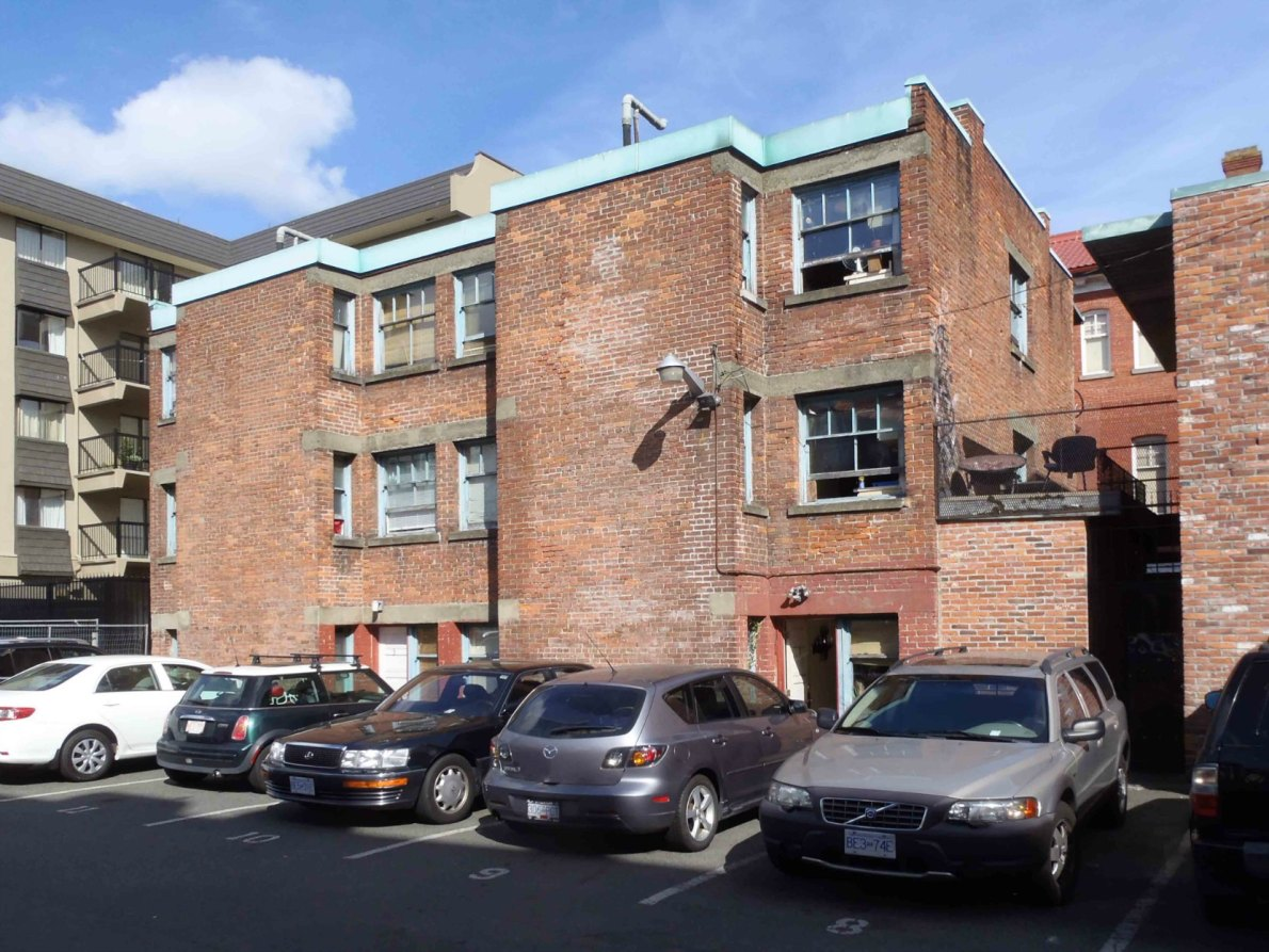 Western side of the tenement building at 624 1/2 Fisgard Street, built in 1913 behind the Gee Tuck Tong Building (photo by Victoria Online Sightseeing Tours)