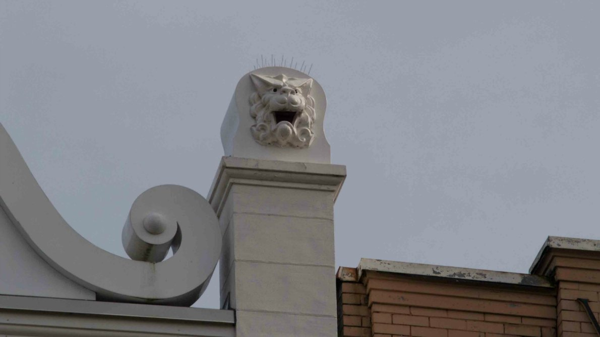 Original lion head decorative detail on the Chinese Empire Reform Association building at 1715-1717 Government Street. (photo by Victoria Online Sightseeing Tours)