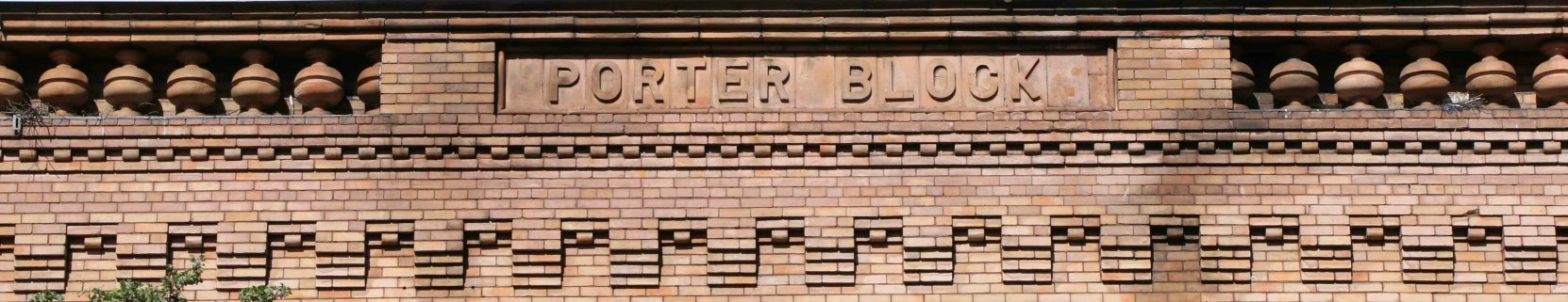 Our web header photo for the Porter Block at 1402-1406 Douglas Street shows the brickwork at the building's cornice.