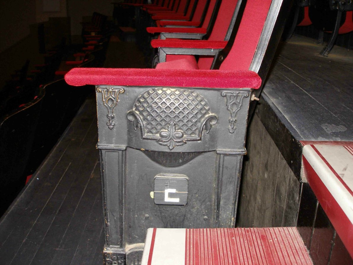 These seating panels are original interior detailing in the McPherson Playhouse, 3 Centennial Square. This theate was built in 1914 by architect Jesse M.Warren and much of its original interior detail is still intact.