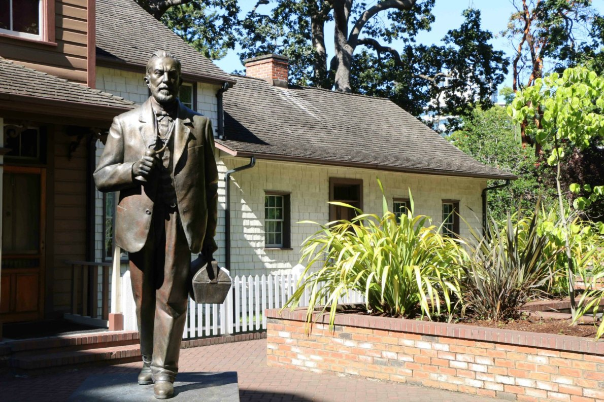 Helmcken House and the statue of Dr. John Sebastian Helmcken, Thunderbird Park
