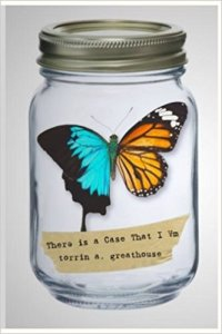 Cover for the chapbook There is a Case That I Am by torrin a. greathouse, a glass Ball jar containing a butterfly with an aqua blue and black left wing and an orange and black right wing and a piece of masking tape upon which the book title is typed.