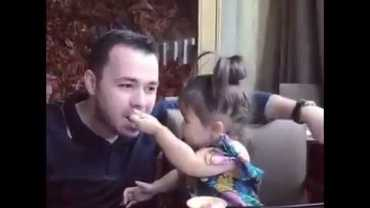 Cute Little Girl Feeding Her Father