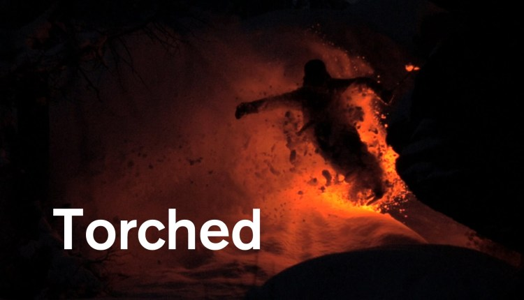 Awestruck View Of Skiing In The Dark With A Torch