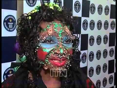 Woman Covered with Piercings