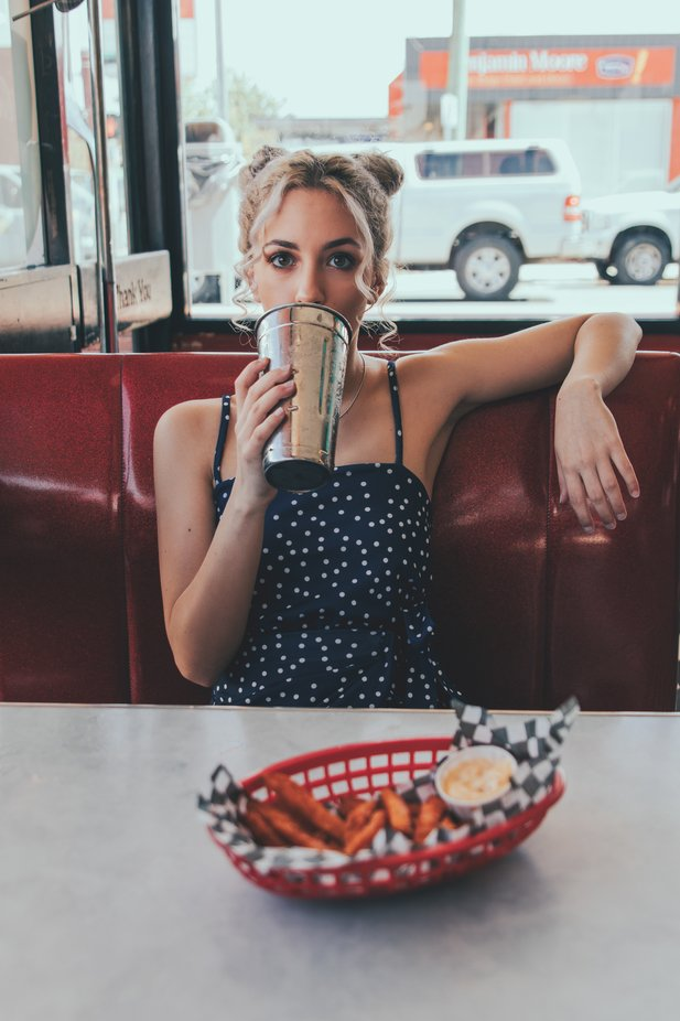 Girl with space bun in retro diner by jayngai - My Best New Shot Photo Contest