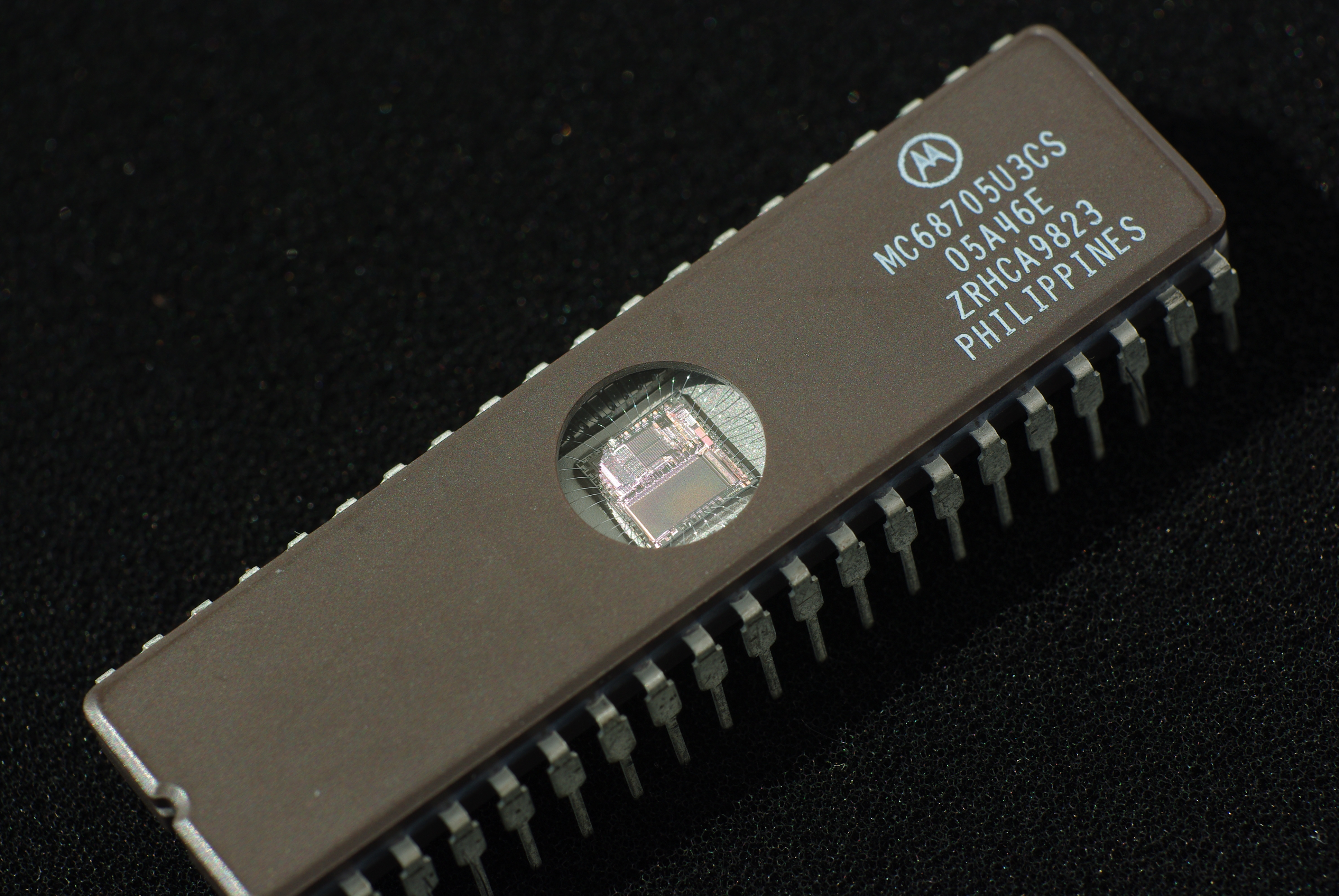 EPROM chip - notice the clear glass where you can shine UV light through to erase the memory!