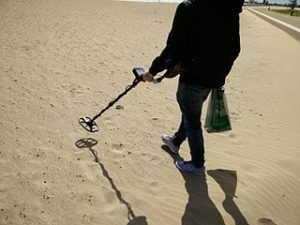 man using metal detector