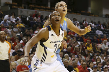 Tamika Catchings blocks out Chicago's Elene Delle Donne.