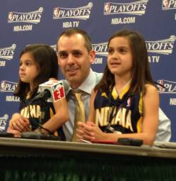 Coach Vogel with his two daughters at a playoff press conference.