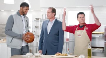 Paul George and Jim Nantz featured in a Papa John's commercial with John Schnatter last year.