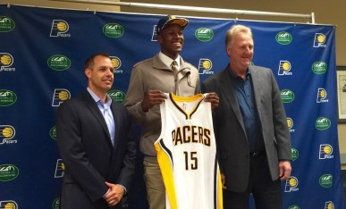 Myles Turner poses with coach Frank Vogel and team President Larry Bird.