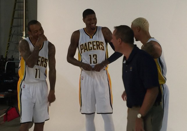 Frank Vogel jokes around with his starting backcourt prior to the 2015-16 season.