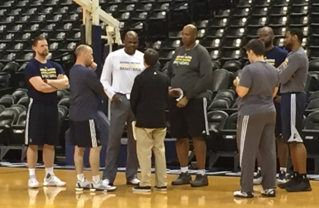 Ryan Carr (black) talks with the Pacers' coaching staff following a workout.