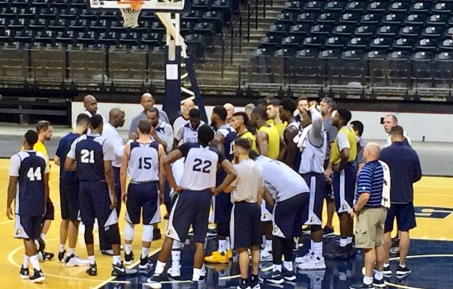 McMillan huddles up with the team to end practice.