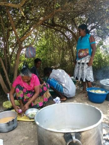 Villagers-prepare-meals-in-makeshift-kitchen