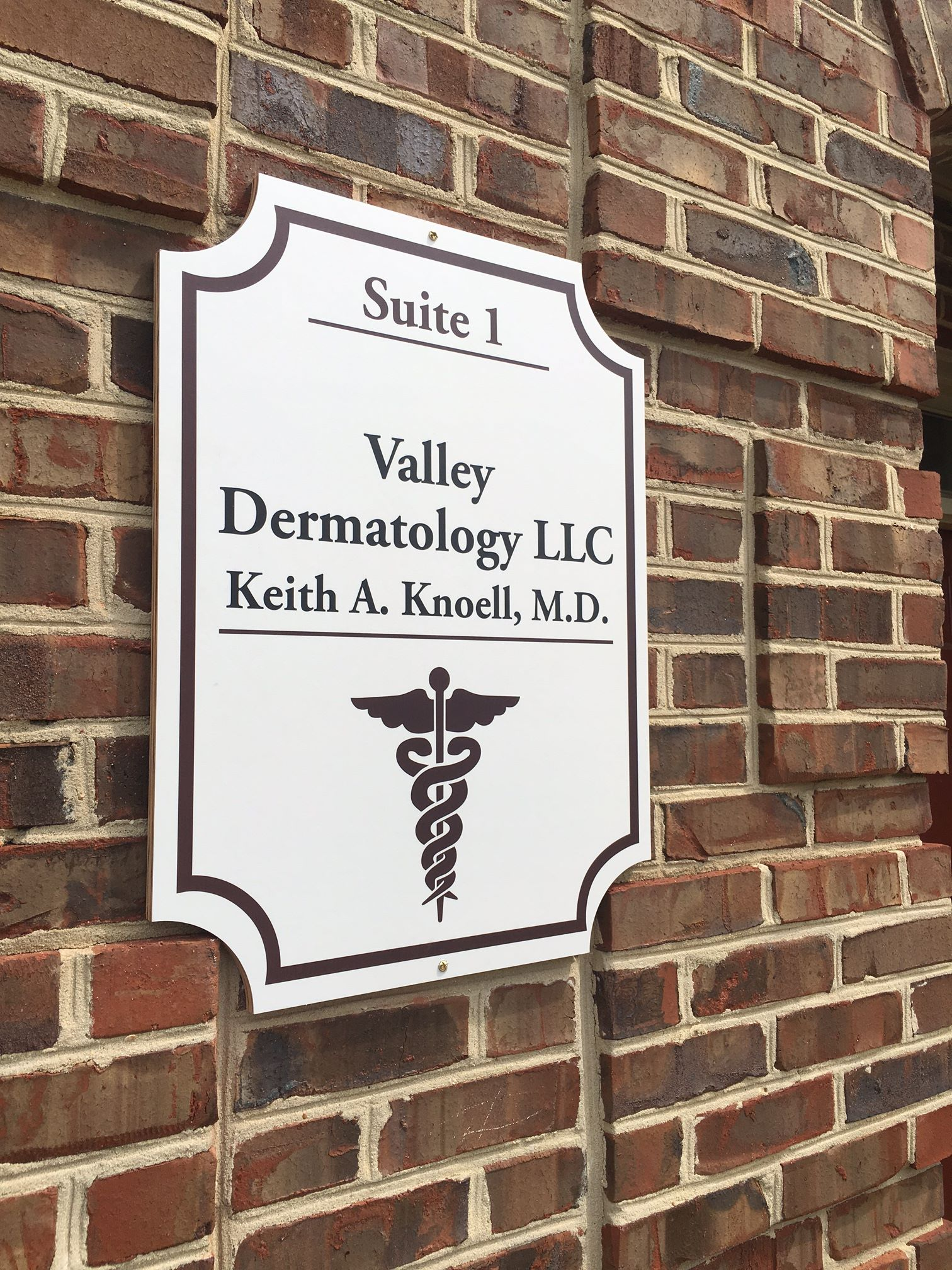 valley dermatology wooden sign