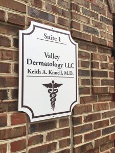 valley dermatology wooden sign